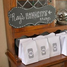 """""""Ray's Favorite Things"""" party favors and chalkboard sign from dad's milestone birthday party décor. 70th Birthday Decorations, 75th Birthday Parties, 70th Birthday Gifts, Birthday Favors, 70 Birthday, 70th Birthday Party Ideas For Mom, Birthday Sayings, Surprise Birthday, Birthday Celebrations"""