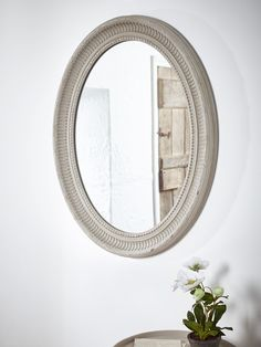 Finished in soft grey with a subtle distressed look, our large oval Evelyn Mirror has been carefully made from Paulina wood. Each weighty frame features a soft ridged edge and beaded details, as well as two picture hooks on the reverse so this mirror can be hung landscape or portrait to suit your space.