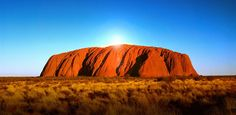 Uluru, or Ayers Rock, is located in the Northern Territory of central Australia and is also a UNESCO World Heritage Site. The sandstone formation appears to change color at different times of the day and year--especially at dawn and sunset, when it appears to glow red.