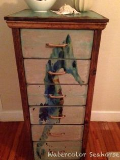 Seahorse Water Color 6 Drawer Chest Features a primitive wood finish top with natural pine reclaimed wood structures. Twine wrapped drawer pulls. Paris Chest