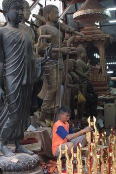 Bangkok, Thanon Bamrung Muang. Shops with Buddha statues and religious items.