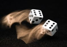 This is a motion blur image of the dice rolling, it is an image taken with slow shutter speed.
