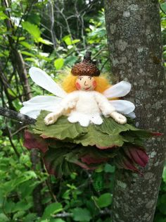 Green and white flower fairy on Etsy, $11.00