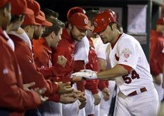 St. Louis Cardinals' Jaime Garcia is congratulated by teammates after hitting a solo home run during the third inning of a baseball game against the Cincinnati Reds, Monday, Oct. 1, 2012, in St. Louis.