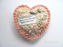 crazy quilted heart pin with crocheted edge