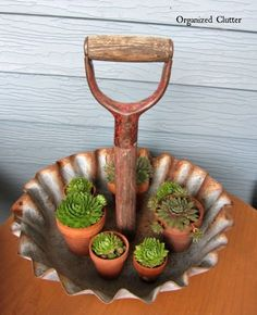 Organize odds-and-ends in this rustic shovel-handle display tray. Use it for little succulents, jewelry, or even cupcakes. Get the tutorial at Organized Clutter.