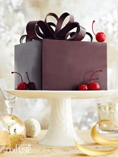 Layers of decadent mud cake and brandied cherries wrapped in chocolate make a stunning Christmas dessert (cover recipe from our December 2011 issue) ~ recipe Michelle Southan ~ pic Brett Stevens