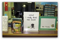 I'm using this simple sign at my desk to prompt book talks with students. Quick and easy! Just replace the book after a student checks it out.