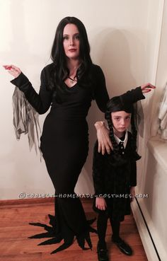 Cool Homemade Mom and Daughter Couple Costume: Morticia and Wednesday Addams with Thing... This website is the Pinterest of costumes