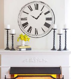 Make Layering Work  For an affordable mantel artwork update, try a decal to add visual interest without the cost of a gallery piece. Consider the size of the wall above your mantel and the width of the fireplace when picking out a decal to choose a design that isn't too small or too large.
