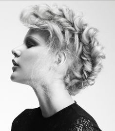 A short blonde curly shaved hairstyle by HOB Salons