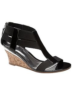 With patent details and a sleek, metallic accent at the heel, our zip-back wedge sandal takes a shine to all your warm weather looks. Designed for a season of comfort, this wide width wedge features stretchy straps and a padded sock. Non-slip sole. lanebryant.com