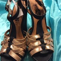 Rue 21 Black And Gold Wedge A black patient wedge and gold straps cris- cross on top of shoe . Has a black strap around ankle . Has 5 in heel and 1 in platform . Rue21 Shoes Wedges