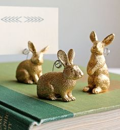 Make Bunny (or any other animal) place card holders Tutorial. Can also cut them in half, paint, and glue on magnets to hold each half together with card in the middle.