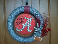 DIY Wreath I made! Super Simple--used ribbon, wreath picks, scrapbook paper and modge podge!