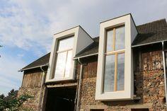 Ein schickes Beispiel für Modernisierung: ein Haus im Haus - modernes Wohnen im alten Gewand.
