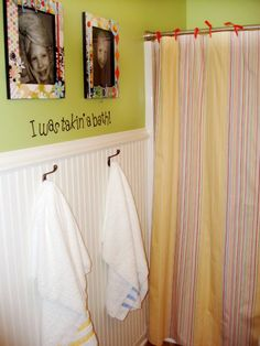 Kids bathroom idea.  Replace the towel bar with hooks and I LOVE the cute pics over them!