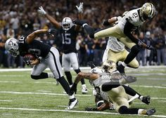 Seth Roberts #10 of the Oakland Raiders scores a touchdown during the second…