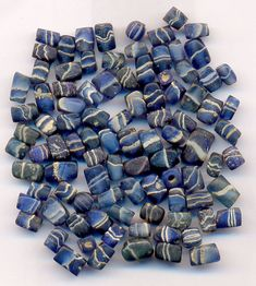 Ancient glass beads Average size: 6 * 3,5 mm  Wonderful blue colored glassbeads with stripes. The square beads: Greater India - probably Maurian Period 300 B.C. - 100 A.D. http://www.ancientbead.com/Ancient_glass_beads.html