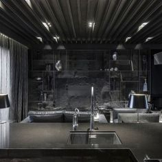 awesome-home-in-black-design-with-black-modern-kitchen-design-and-black-marble-countertop-stainless-steel-faucet-black-leather-covered-sofa-black-stone-wall-black-curtain-glass-window-black-standing-lamp