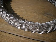 Close up of a pull tab byzantine link necklace.