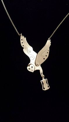 Sterling silver necklace. Barn owl woodland pendant with dangling lantern. Handmade and unique pendant on sterling silver chain.: