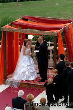 Wedding Ceremony! The Chuppah/Arch's framework was custom created in our studio, then draped with flowing organza in red and orange hues.  Image courtesy of @Damon Tucci Photography