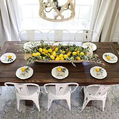 If you've been watching my IG stories lately, you'll know I've been lemon-izing the house for summer for the past couple weeks...and they make me smile in here!  Filled a huge vintage dough bowl with faux lemons and olive stems from Hobby Lobby and Amazon, and then these sweet little linen napkins from @kitchstudios made a perfectly simple table setting...of course topped off with a wee little lemon.   Can't wait to show you the rest of the space!  Whatcha think?! Has life handed you ...
