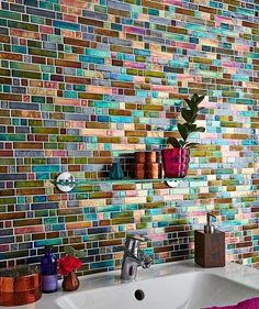 Metallic colour creates a beautiful peacock effect in your home, use tiles to create a bright feature in your kitchen or bathroom. Add similar colours with accessories to bright the room to life.