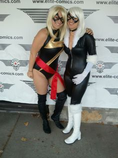 "Ms. Marvel and Black Cat cosplay by Hillary and Alyssa Lewis. Both wearing ""Excitement"" leather masks by Ravenwood Masks. Photo by Steve Daniels."