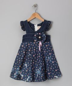 From its fluttery angel sleeves and bow embellishment down to its full floral skirt, this denim delight pulls together an assortment of darling details to create one precious, picture-perfect look. 100% cottonMachine wash; tumble dryImported
