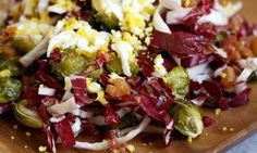 A roasted salad with bacon recipe perfect for a holiday side dish. The egg mimosa and salty vinaigrette is great with the bitter radicchio and sprouts.