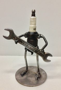 "The Mechanic. Junk art sculpture made from some scrap steel, a spark plug and an old wrench. Made by Brookwood Garage. Search ""Brookwood Garage"" on Etsy to purchase."