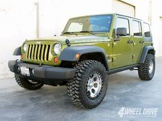 "2007 Jeep Wrangler Unlimited 2"" lift 33"" tires"
