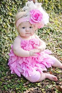 LOVE this dress..........I think she might kill me if I put that on her head however! Adorable