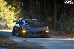 Matte black Mazda RX-8 with yellow fog lig http://flanaganmotors.com
