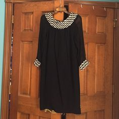 Vintage black and white dress Dress is from the 1950s or 1960s I believe. Sleeves are sheer, body is solid black material. Loose fitting, zippered back. Would love to pass along to another vintage lover! Price is $30 or reasonable best offer. Dresses