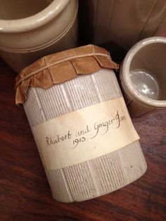English Hartley jam or marmalade crocks I bought in London. The one with the cover and label was used on a movie set. Originally it would not have had the brown paper top or hand written label.