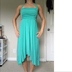BCBG Maxazria Green Holiday Cocktail Formal Dress -like new, worn once for 3 hours  -beautiful sea green color  -halter top, asymmetrical hem -super stretchy and form fitting -so soft and comfy to wear -built in matching sash that ties in the back  -fully lined -very small and unnoticeable tear in the halter tie; see last picture  -69% acetate, 23% nylon, 8% spandex   Measurements  Bust: 26 inches  Length: 30 inches   Check out all my other listings for combined shipping! BCBGMaxAzria…