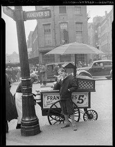 Hotdog stand in North End, corner of Hanover and Blackstone Street, Boston, 1937 by Boston Public Library Old Pictures, Old Photos, Vintage Photos, Boston Pictures, Boston North End, Boston Usa, Boston Town, Hot Dog Cart, Hot Dog Stand