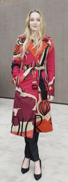 Festive campaign star Hannah Dodds wearing a vibrant printed Burberry trench coat at the Burberry Prorsum Menswear A/W15 show