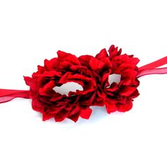American Beauty! Do you remember that film..? This is the perfect homage to it, a Limited Edition mask made from an authentic Venetain Papier Mache base that is absolutely covered in red Rose petals - fastens with red satin and organza ribbons