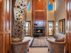 Living Room with World-Class Climbing Wall I see no reason not to have this in my house