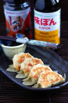 Japanese-Style Dumpling (Gyoza) - a tiny parcel of juicy filling encased in a dumpling wrapper, pan-fried to crispy golden brown at the bottom. #pork