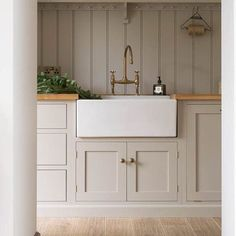 modern farmhouse kitchen, laundry room, or mudroom with light gray taupe cabinets and farmhouse sink Painting Kitchen Cabinets, Kitchen Paint, New Kitchen, Kitchen Decor, Kitchen Ideas, Taupe Kitchen Cabinets, White Cabinets, Kitchen Interior, Shaker Cabinets