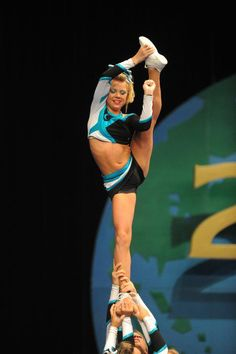 Katherine Smith, cheer, competition, stunt, heel stretch headed towards bow and arrow, cheerleading, cheerleader  (may move to another cheer board but still doing reorg)