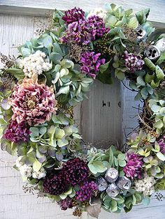 Wreath with dried roses and hydrangeas.