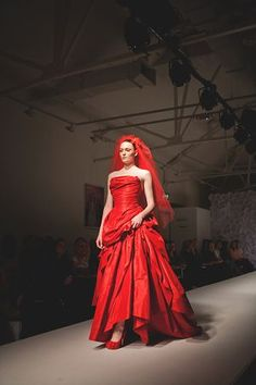 Red wedding dress and veil by Vivienne Westwood, for The Luxury Wedding Show, Saatchi Gallery, London, October 2012...
