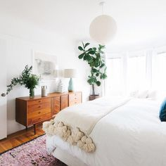 Proof that a little vintage goes a long way. ✔️ Because that dresser in this room is SO good. And since we're being honest…the pom poms are pretty perfect too. // by @homepolish by at1stsightbk http://ift.tt/1SOXYLb
