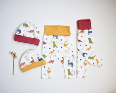 Modern baby kids and humorous grown ups accessories. by Zezling Kids Slippers, Muslin Blankets, Baby Dinosaurs, Baby Lovey, Baby Jogger, Baby Leggings, Soft Dolls, Baby Room Decor, Baby Prints